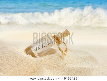Bottle With A Message On Sand Beach
