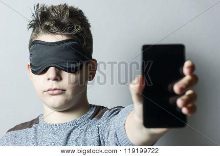 Sleepless Boy With Sleep Mask Holding And Showing Smart Phone