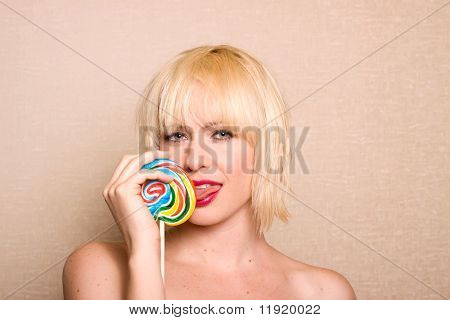 Woman eating a colorful lollipop