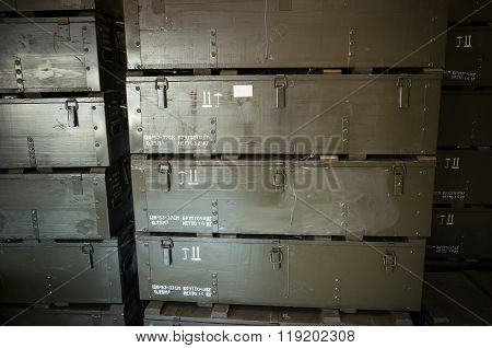 Stacks Of Dark Green Wooden Boxes For Ammunition