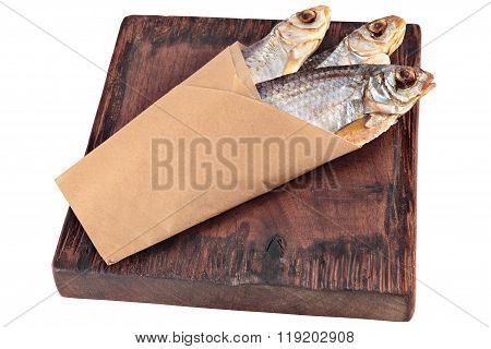 Stockfish On Brown Square Wooden Board, Wrapped In Paper, Isolated.