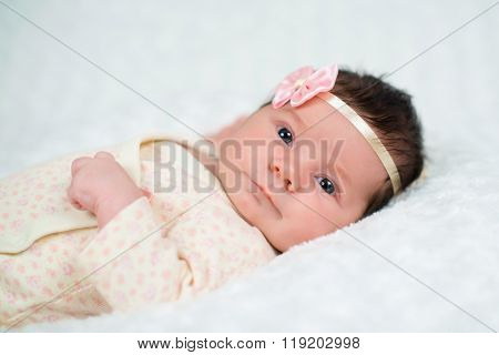 Cute Newborn Baby Girl With Pink Bow