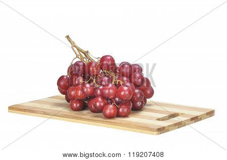 Delicious Bunch Red Seedless Crimson Grape On Bamboo Chopping Board Isolated On White