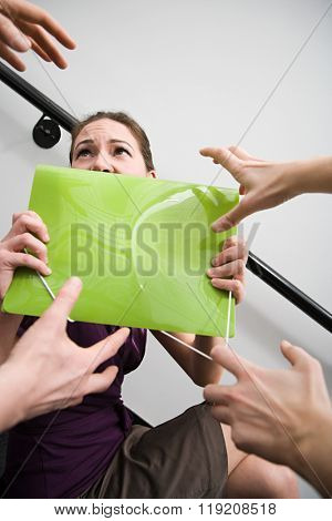 People trying to grab file from woman