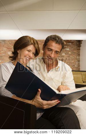 Mature couple looking at photo album