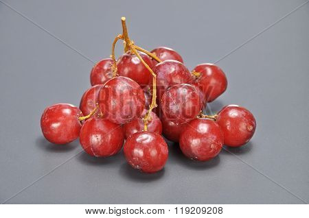 Delicious Bunch Red Seedless Crimson Grape On Grey Background