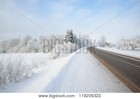 S-shape Rural Road Through A Winter Wonderland With Rime