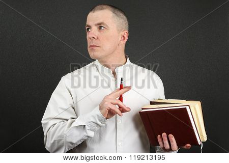 White Man With A Pen And Books In Their Hands