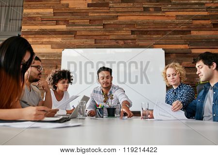 Team Of Young People Having A Meeting In Office