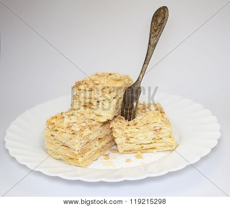 Cake Pieces On A White Background On A Plate With A Fork