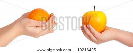 Children's hands give Orange and yellow Apple