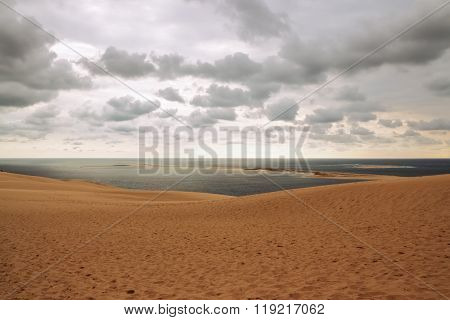 Dune Of Pilat, View Over The Ocean And Cloudy Sky