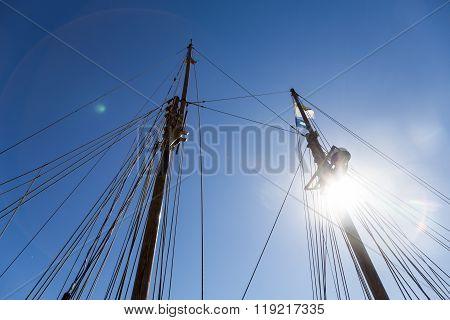 Ship's Mast, Blue Sky, Sun And Flags