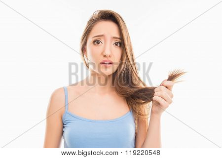 Sad Unhappy Young Girl Showing Her Damaged Split Ends