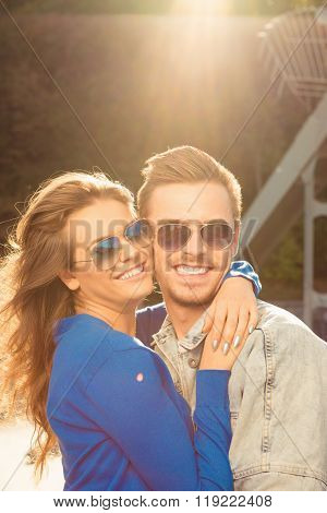 Cheerful Romantic Couple In Love On The Bridge Huging Together