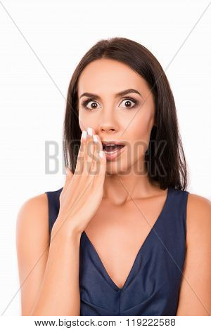 Portrait Of  Surprised Shy Young Woman On White Background