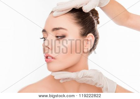 Close Up Photo Of  Doctor's Hands Checking Skin Before Plastic Surgery