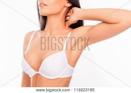 Portrait Of Shapely Young Woman In White Bra Touching Her Neck