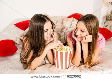 Bachelorette Party. Two Girls Lying On The Bed And Eating Popcorn