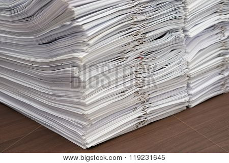 Pile Of Documents With Clips On Desk Stack Up