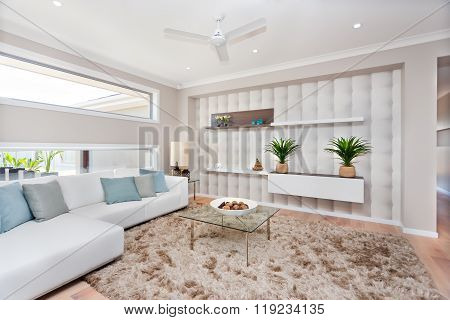 Living Room In A Luxurious House With Natural Decoration And White Sofas