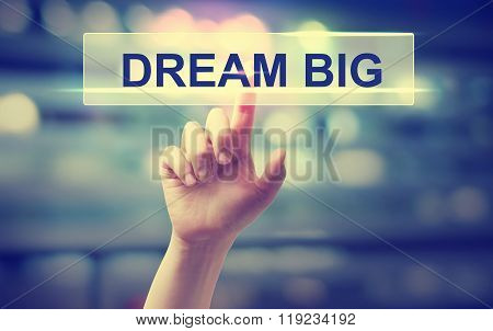 Dream Big Concept With Hand Pressing A Button