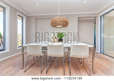 Modern Dining Room Design With Table Set Up And Natural Decorations