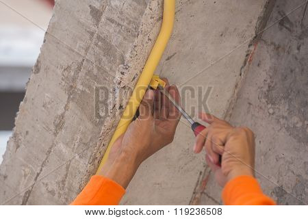 Worker Install Pvc Pipes For Electric Conduit