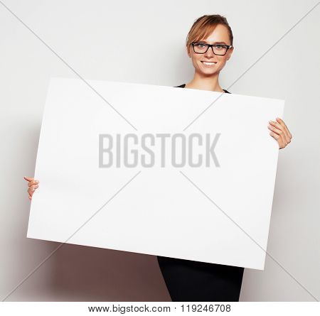 business woman holding a blank billboard.