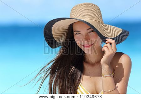Asian woman wearing fashion straw beach hat for skin care sun protection. Face skincare beauty concept. Beautiful Chinese Caucasian mixed race young adult girl portrait on summer vacation travel.