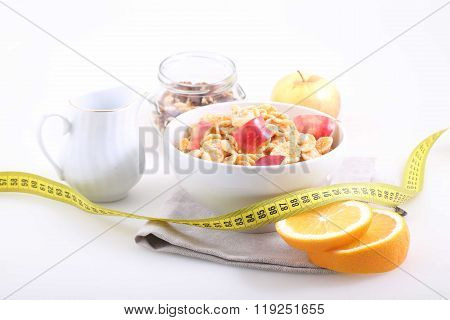 Muesli With Apple Slices, An Orange And The Measuring Tape, A Useful Breakfast
