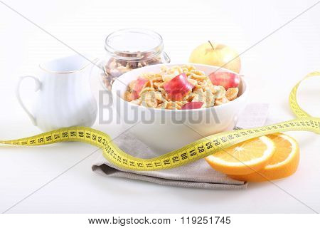 Corn And Rice Flakes With A Fresh Apple, An Orange And A Measuring Tape