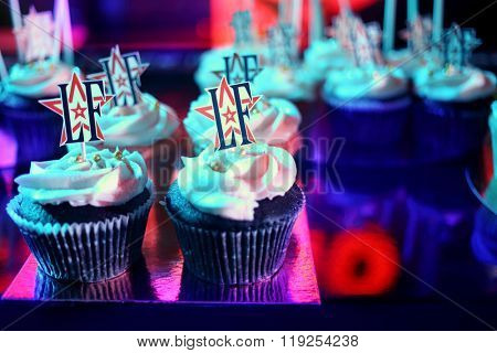MOSCOW APR 26, 2015: Tasty muffins decorated with cream on the celebration of glossy magazine LF city birthday