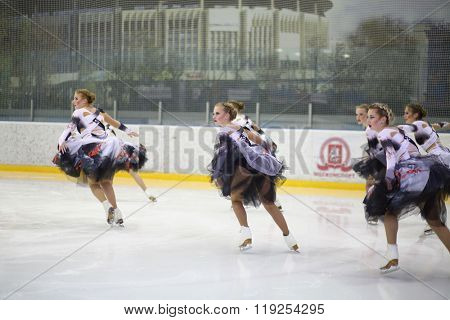 MOSCOW - APR 26, 2015: Girls team in lush skirts on skates at the Cup in synchronized figure skating in the sports complex Olympiysky