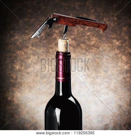 Closeup Corkscrew In A Wine Bottle