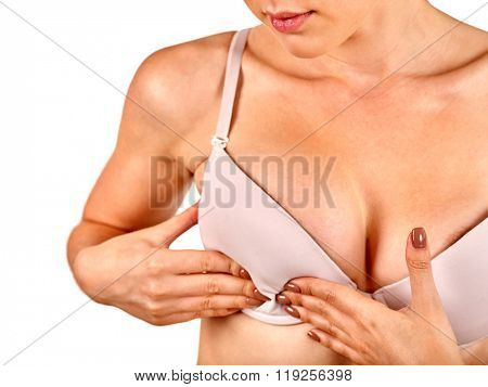 Breast self exam. Girl examines her breasts. Medicine concept.