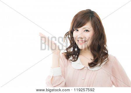 beautiful young girl showing copy space