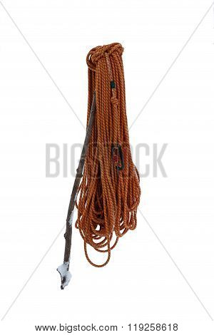 Hank Of climbing rope with a black shackle traces of frost and snow wearing a stick.