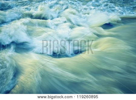 abstract background or texture blur retro autumn wave rapid river water
