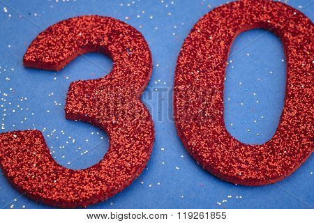 Number Thirty Red Color Over A Blue Background. Anniversary