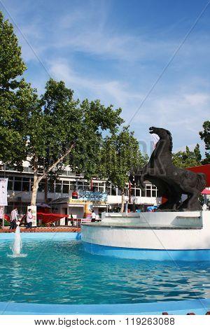 Novi Sad, Serbia: May 11, 2015 - Visitors and Horse fountain on Agricultural Fair in Novi Sad
