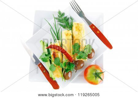 cheese cannelloni served with vegetables on white dish