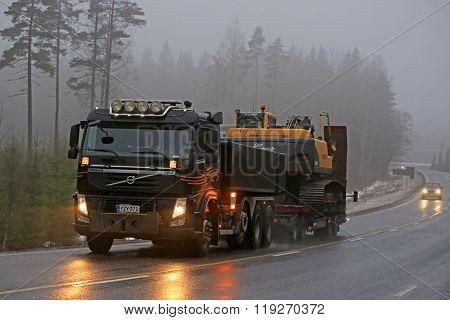 Volvo FM Semi Hauls Crawler Excavator In Fog