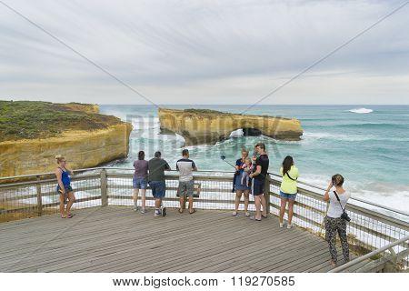 Tourists in London Arch, Australia