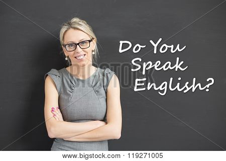 Woman with crossed hands standing and promoting english courses