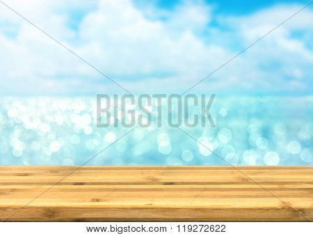 Empty Wood Table Top For Product Disply With Blur Blue Ocean And Sea View Bokeh Light
