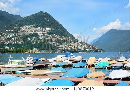 LUGANO, SWITZERLAND - JULY 5, 2014: Boats at dock. Lake Lugano is a glacial lake on the border between Switzerland and Italy.