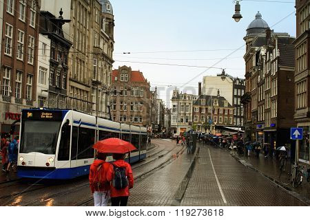 Amsterdam, Netherlands - Aug 18, 2015: Street Of An Old Town Of Amsterdam In The Evening Under The R