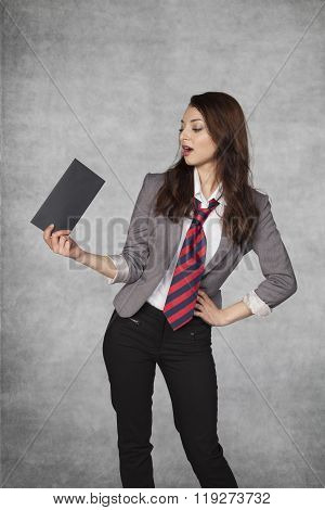 Young Businesswoman Holding An Envelope With A Bribe