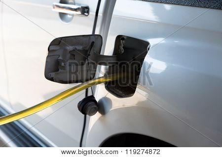 People Using Rubber Tube To Fill Up The Gas Tank